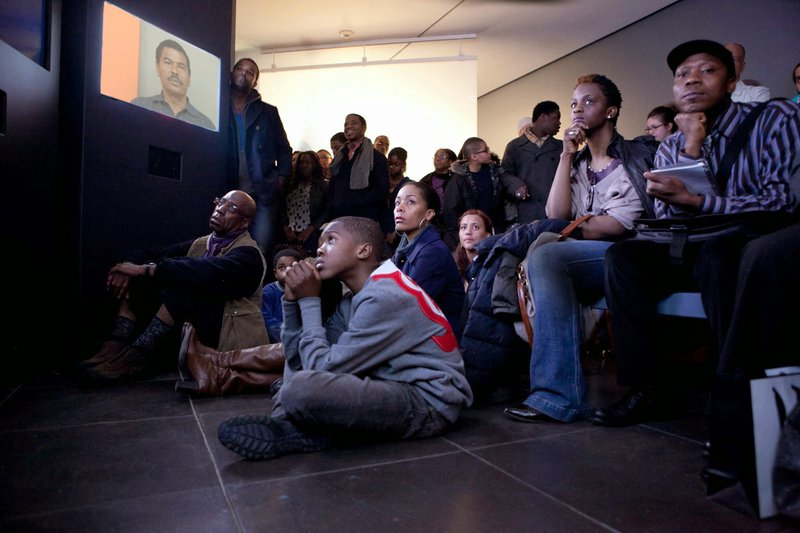 "<p>""Question Bridge"" (2012) is a transmedia project encouraging dialogue among Black men across the US. In ""Question Bridge"", participants pose and answer questions for each other, creating a conversation that others can participate in and learn from through in-person installations, a website, and a mobile app.</p>"