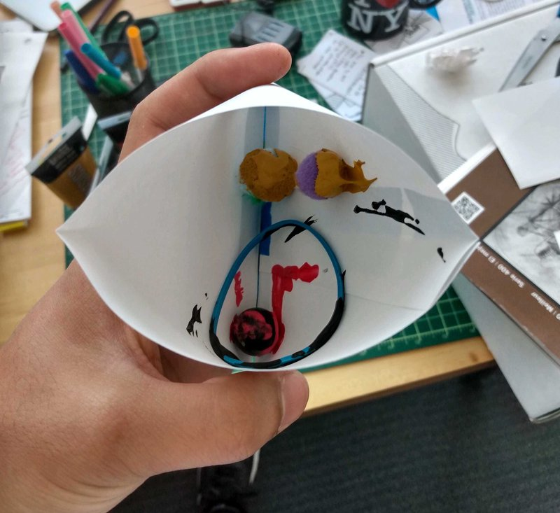 """<p>View of the art payload before launch…we rolled up some white paper, added paint and random objects to do the """"painting,"""" and placed this into a model satellite!</p>"""