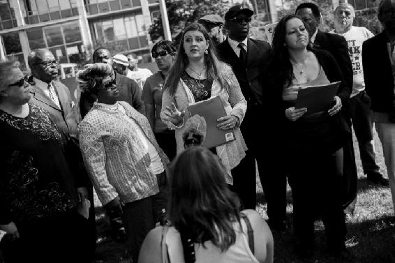 <p>Figure 6.6<br>Press conference with activists and Flint Water Study team announcing sampling results. <em>MLive, Flint Journal.</em></p>