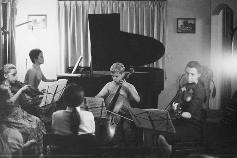 Millie and the kids perform chamber music for their guests (like Aviva).  Photo courtesy of the Dresselhaus Family
