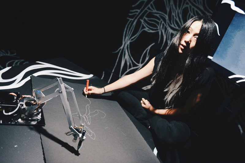 <p>Sougwen Chung's work with machines involves live performance and studio arts.</p>