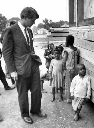 <p>Photographer Dan Guvarich snatched a picture of Senator Robert Kennedy, not in some humanitarian mission in Africa or Latin America, but at the Delta of the Mississipi, 1967, seeing the American hunger with his own eyes. Image courtesy of the JFK Library.</p>