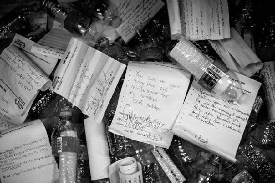 <p>Figure 8.3<br>You Owe Me bottles delivered by Flint Rising activists to State Capitol. <em>MLive, Flint Journal.</em></p>