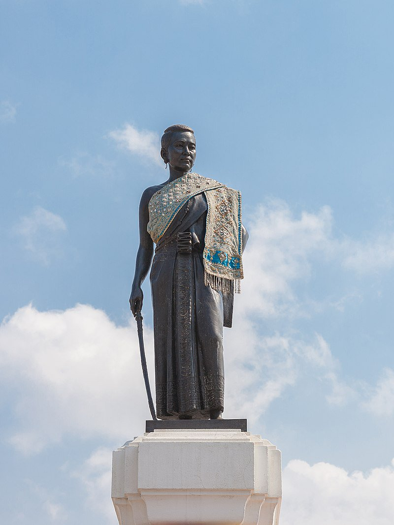 "<p>Image of the statue of Lady Mo in Korat, Thailand (source: <a href=""https://en.wikipedia.org/wiki/Thao_Suranari#/media/File:Thao_Suranari_Monument_(I).jpg"">https://en.wikipedia.org/wiki/Thao_Suranari#/media/File:Thao_Suranari_Monument_(I).jpg</a>)</p>"