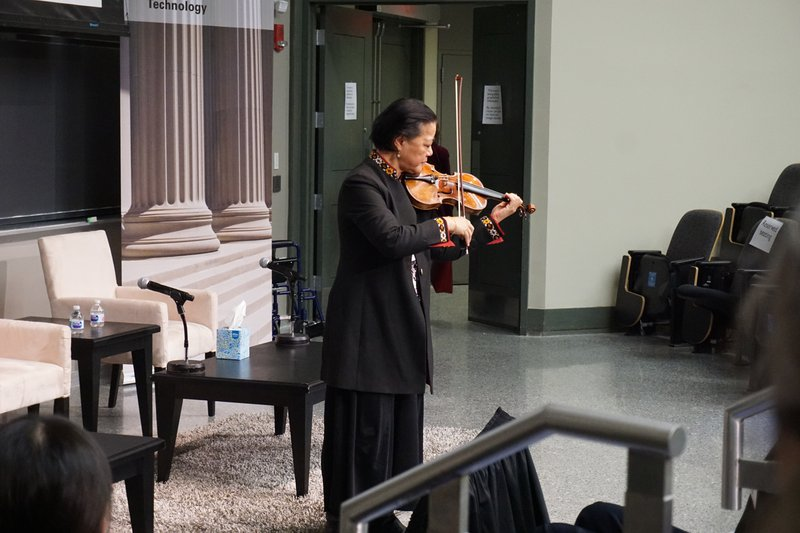 Yeou-Cheng plays at Millie's memorial. Photo credit: Geof Cooper