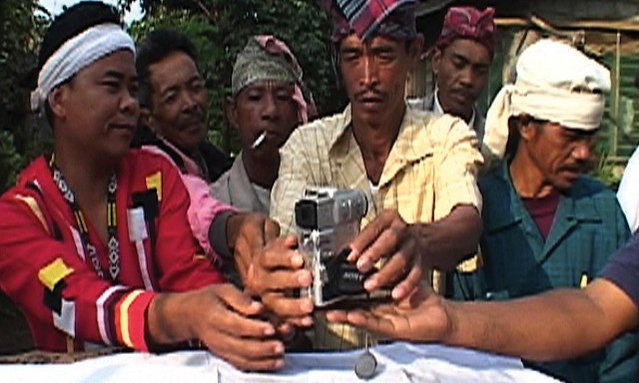 "<p>The Nakamata Tribal coalition in Mindanao, Philippines, accept a video camera from Witness, in a traditional ritual. From ""Seeing is Believing"" (2002).</p>"