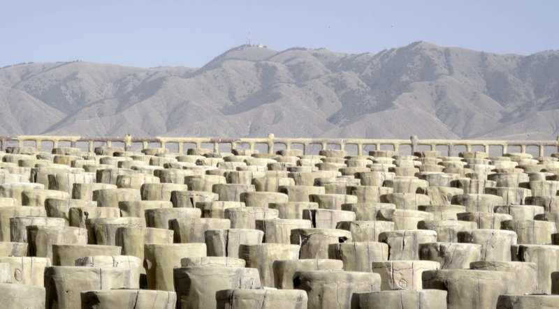 Foreground-Seating area for Hongsibu's annual airshow in the shape of a deforested landscape. Background- Loushan Mountain. Source: Photographed by Felix Kalmenson.