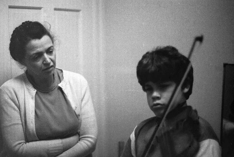 Millie helps Paul practice violin.  Photo credit: Gene Dresselhaus.