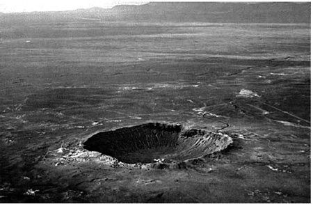 <p><strong>Fig. 2.6</strong><br>Oblique aerial view of Meteor Crater in Arizona. USGS photo by David J. Roddy.</p>