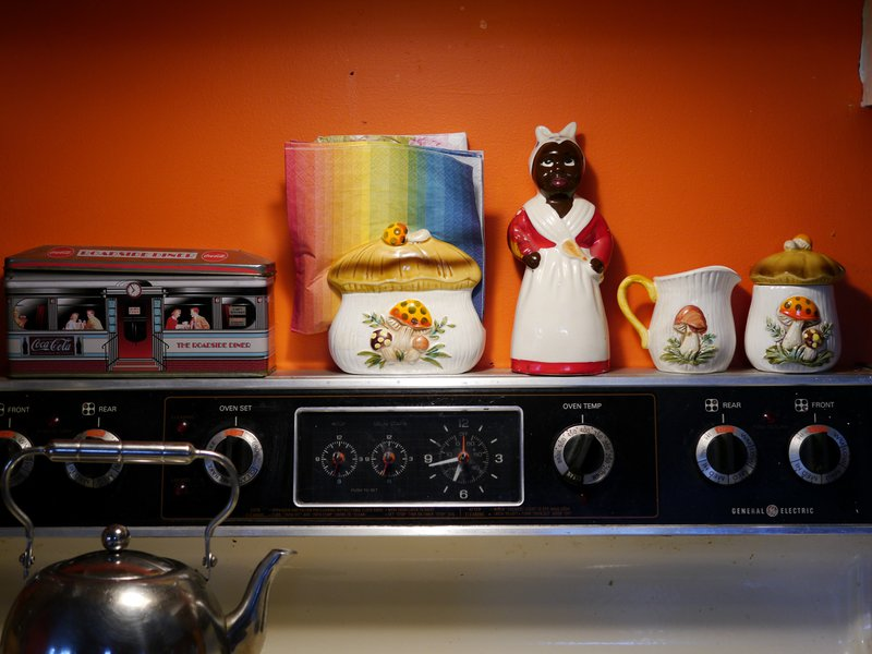 <p><strong>Figure&nbsp;3:&nbsp;</strong>In my home, above the stove is where I put important things. I put her up there to see if she belonged. First, it was awkward, but then she became at home there.</p>