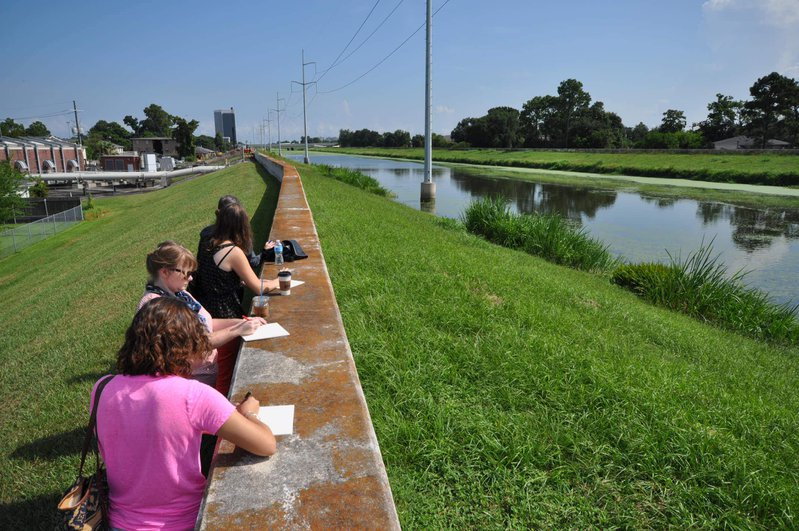 <p>Ripple Effect teachers drawing diagrams and noting their observations of an urban canal, to track the flow of water through the city.</p>