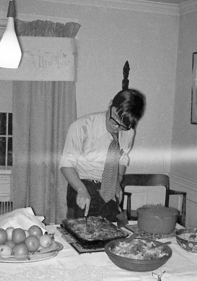 Jim Tsang serves his lasagna at a group party. Photo courtesy of Marianne Dresselhaus Cooper