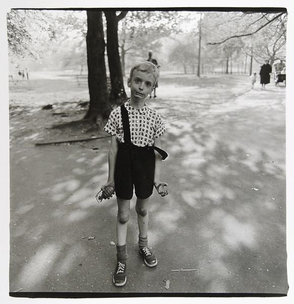 <p>Child with a toy hand grenade in Central Park, N.Y.C., 1962. (Photo by Diane Arbus)</p>