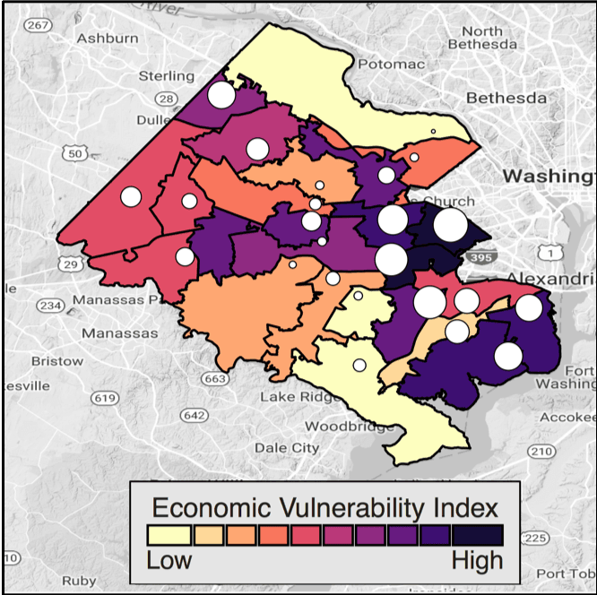 <p><strong>Figure 5.</strong> <strong>School and economic vulnerability indicators for Fairfax County, Virginia.</strong> Economic vulnerability indicators are mapped by the 24 high school attendance areas and by color; the darker the color, the more vulnerable is an area. The overlaid circles are high school vulnerability indicators geolocated at the high school locations. The larger the circle, the higher the vulnerability of the high school population.</p>