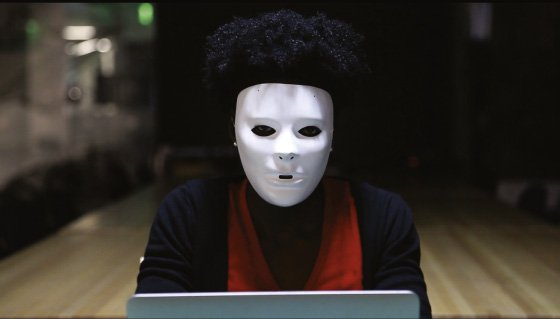 """<p>Figure 1.3: Joy Buolamwini found that she had to put on a white mask for the facial detection program to """"see"""" her face. Buolamwini is now founder of the Algorithmic Justice League. Courtesy of Joy Buolamwini. <em>Credit:</em> Courtesy of Joy Buolamwini.</p>"""