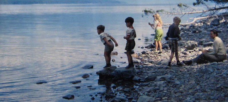 Millie's kids demonstrate the concept of plasmonic excitations by throwing rocks into a pond.  Photo courtesy of the Dresselhaus Family
