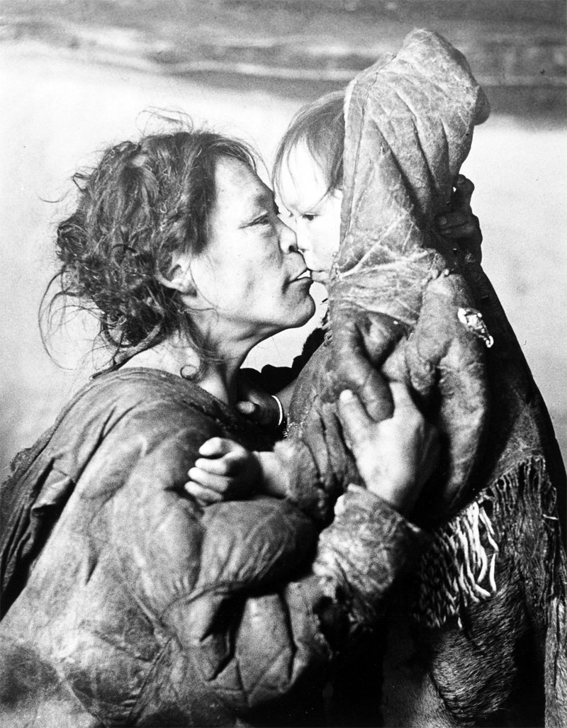 "<p>""Inuit Mother Caresses Her Child in Igloo, Padleimut Tribe, N.W.T.,"" by Canadian photographer Richard Harrington, 1950. (Photo by Richard Harrington)</p>"