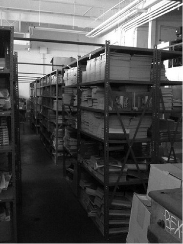 <p>Figure 1.2 An auto shop converted into a book storeroom</p>
