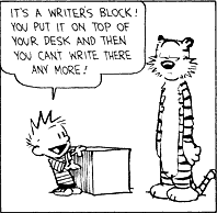 The writer's block is actually a heavy, presumably wooden object.