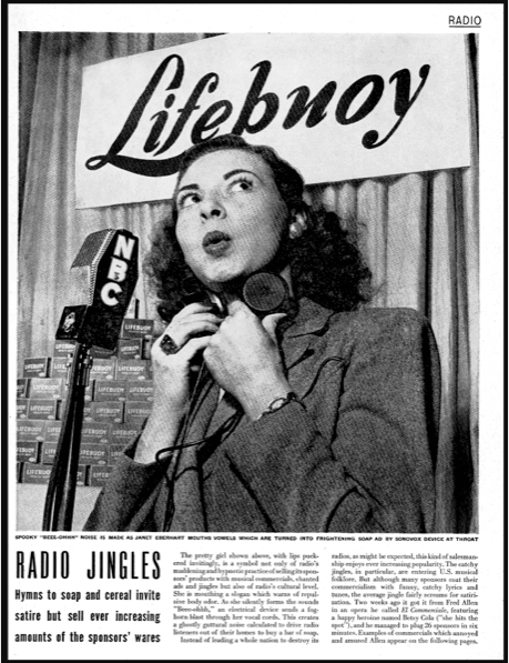 """<p>Figure 4. """"Spooky 'beee-ohhh"""" noise is made as Janet Eberhard mouths vowels which are tuned into frightening soap ad by Sonovox device at throat."""" Image from """"Radio Jingles: Hymns to soap and cereal invite satire but sell ever increasing amounts of the sponsors' wares"""""""" Life Magazine, 21 no. 25, December 16, 1946, 121.</p>"""