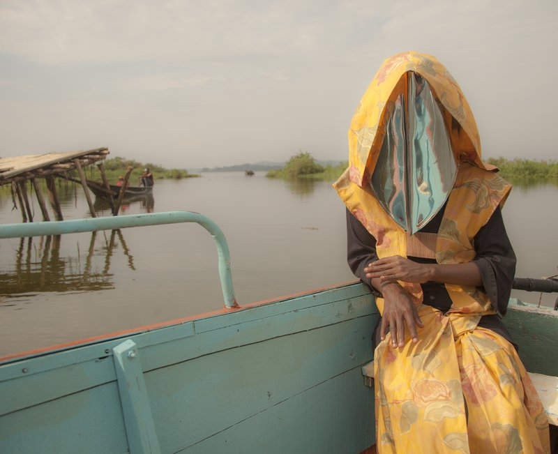 <p><em>The Driver</em>. Photographed by Marisa Morán Jahn, 2017.</p><p>Mask by Jahn and Stephen Etende featuring Darlyne Komukama; collaborators include Alim Karmali, Moses Bwayo, and designer Gloria Wavamunno. Location: Nile River, Uganda</p>