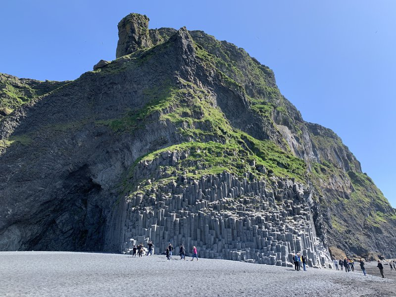 "<p>Black Sand Beach at Vik </p><p>""In a town called Vik there are three spires said to be trolls who were caught in sunlight and transformed to stone as they tried to drag a ship ashore. They're six stories high.""</p>"