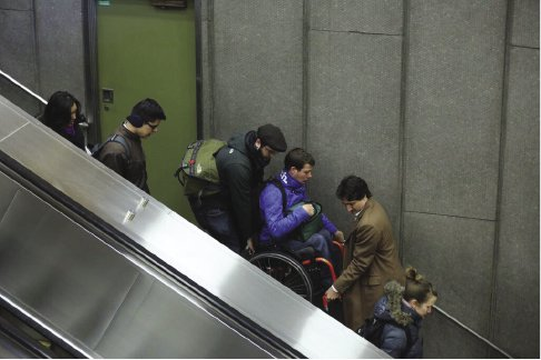 <p>Figure 7.4 In 2016 Canadian Prime Minister Justin Trudeau was photographed helping to carry a wheelchair user down an inoperable escalator at a subway station in Montreal. Adam Scotti, official photographer for the Prime Minister.</p>
