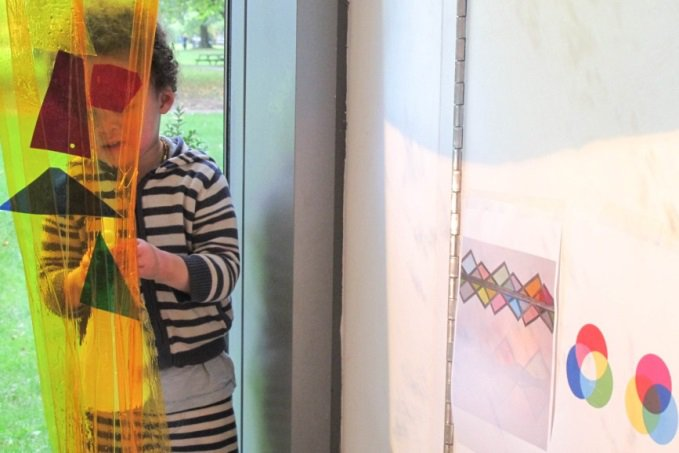<p><em>Figure 4: Charlie creates a 'yellow waterfall' with the cellophane and water. </em></p>