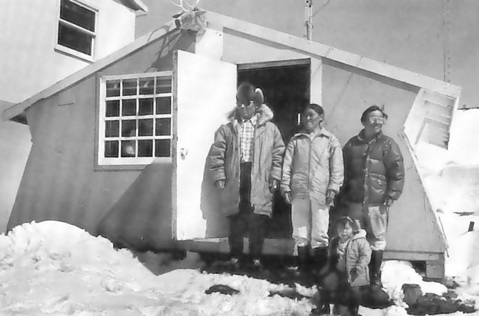 <p>Artists Pudlo Pudlat and Kingmeata Etidlooie in front of the West Baffin Co-op in Cape Dorset, Bagfin Island, Nunavut, in 1976. The Co-op celebrates its 60th anniversary in 2019 as one of the oldest, most successful models of co-ownership in the art world. Photo by Tessa Macinstosh.</p>